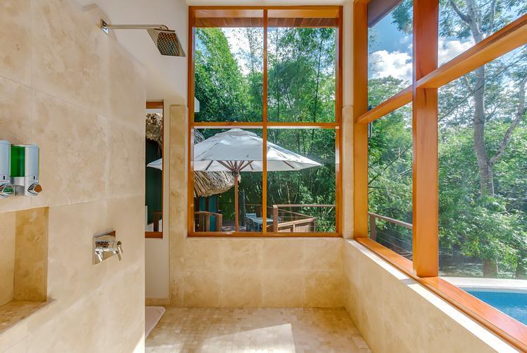 Belize treetop jungle villas chaa creek living shower