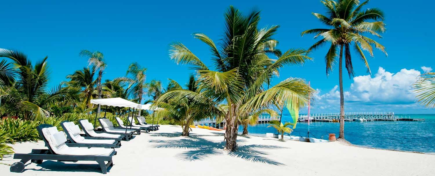 Relax on the beach at Ambergris Caye with Chaa Creek's all inclusive belize vacation package