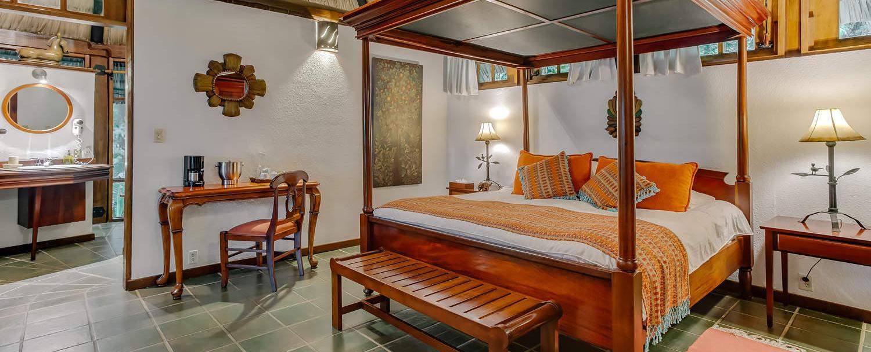 garden jaccuzi suite bedroom at chaa creek belize