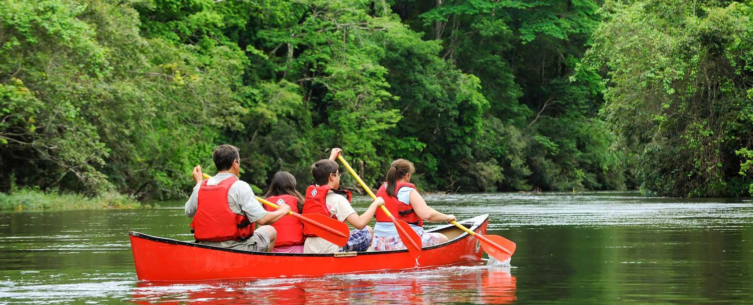 Belize Canoeing Tours with a family at Chaa Creek Resort