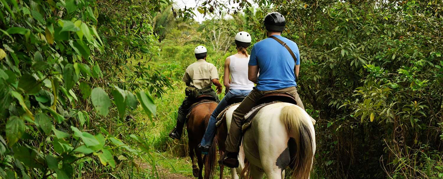 Go horseback riding on our Belize christmas vacation package at Chaa Creek