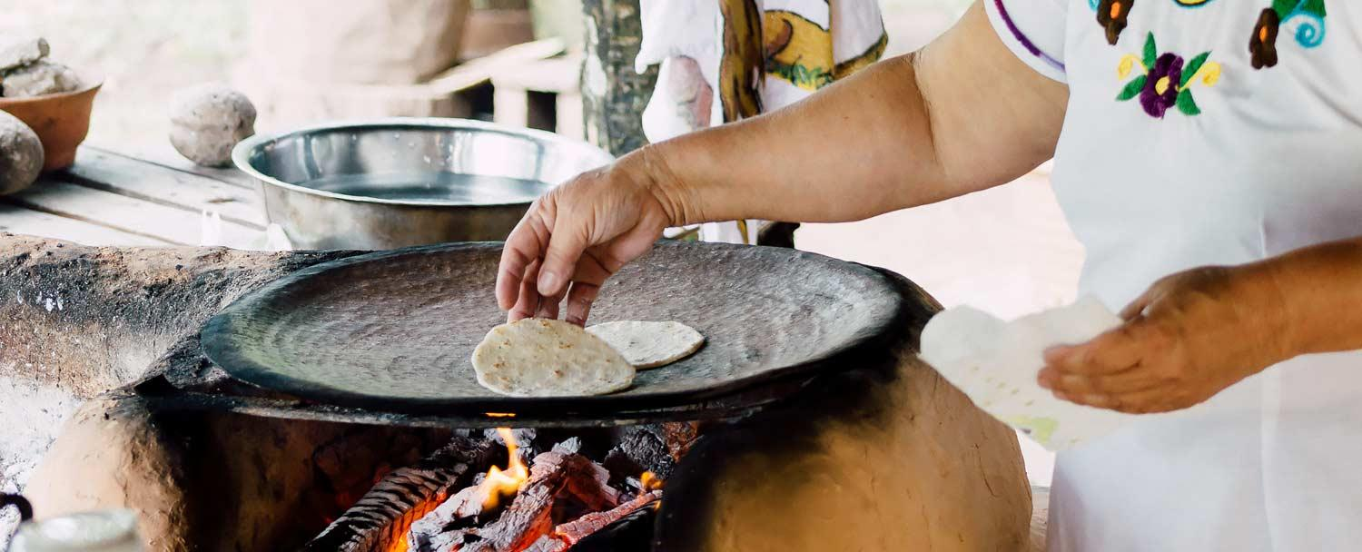 Belize Culture all inclusive package tortilla making at san antonio womens group with Chaa Creek Resort