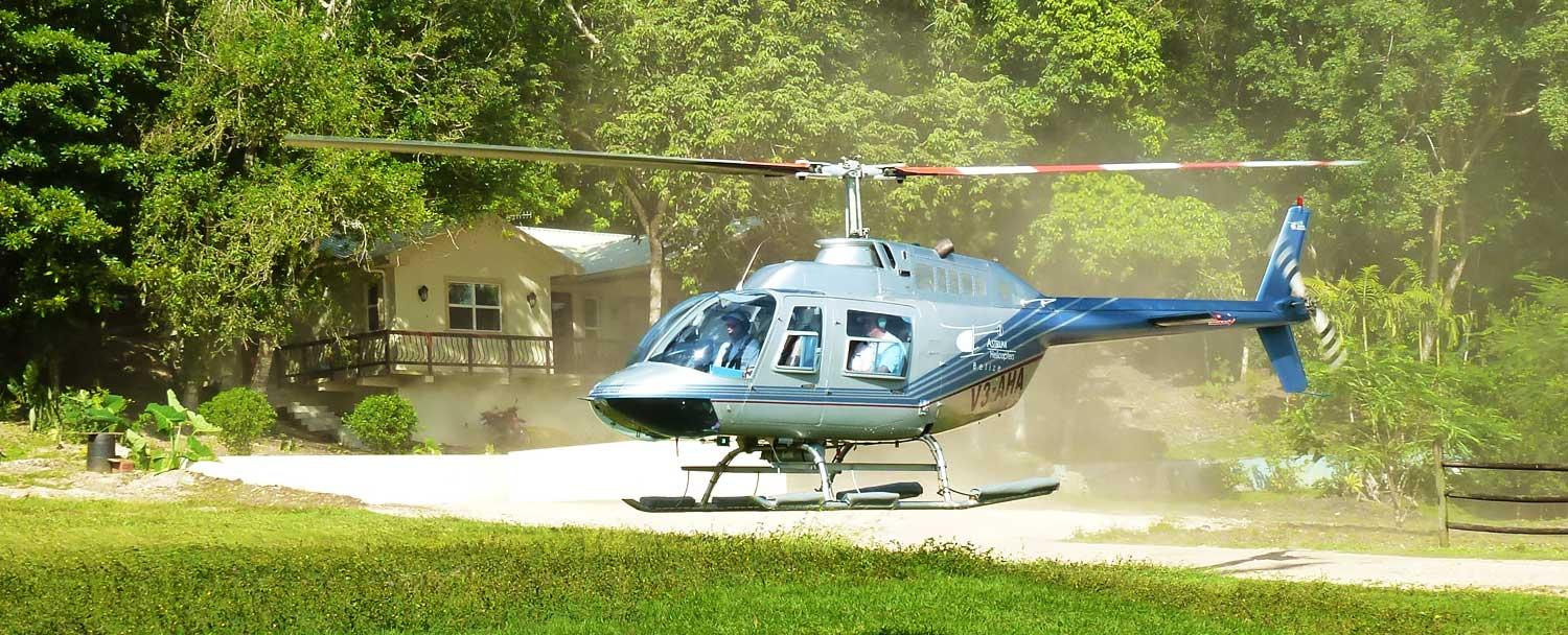 Helicopter landing at Chaa Creek's Belize Heli Pad