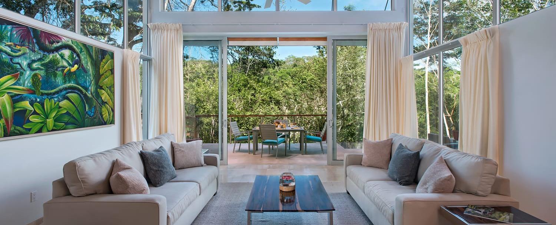 Ixchel Belize Villas interior living room with outdoor view at chaa creek resort