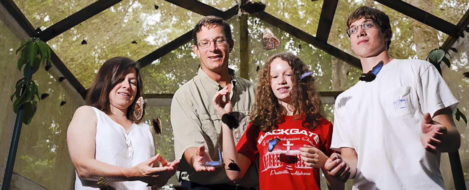 Family enjoying Chaa Creek's Belize Butterfly Farm