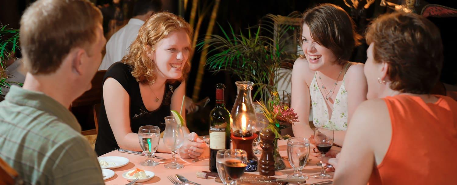 family dining with wine at chaa creek belize jungle resort