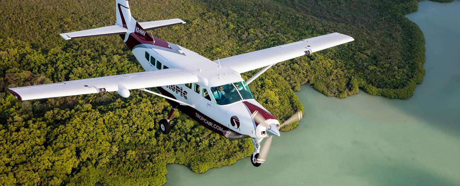 traveling to belize tropic air flying over swamp and mangroves