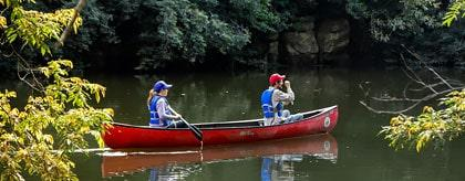 Belize Canoe Tours macal river couple paddling